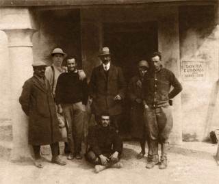 Photograph of team during the excavations of Dura-Europos 1928 - left to right unknown Syrian, Mark Rimmell, Jotham Johnson, Pillet, Susan Hopkins, Clark Hopkins, Achille the houseboy (seated), in the doorway of the expedition house.