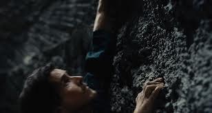 Bruce Wayne climbs