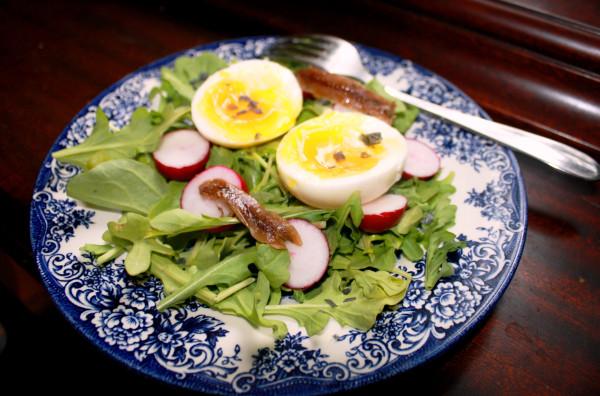 Salad with radishes anchovies black salt