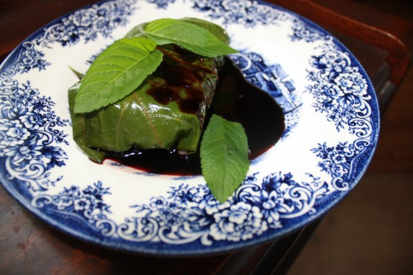 Wild greens Chicken thighs in grape leaves with elderberry sauce