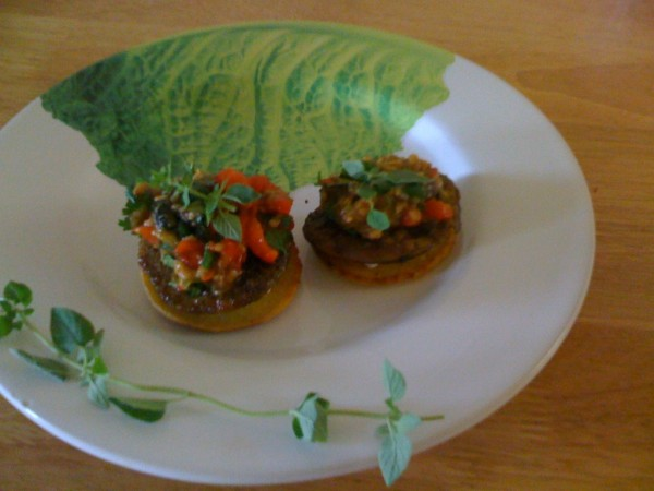 Eggplant appetizer on corn rounds