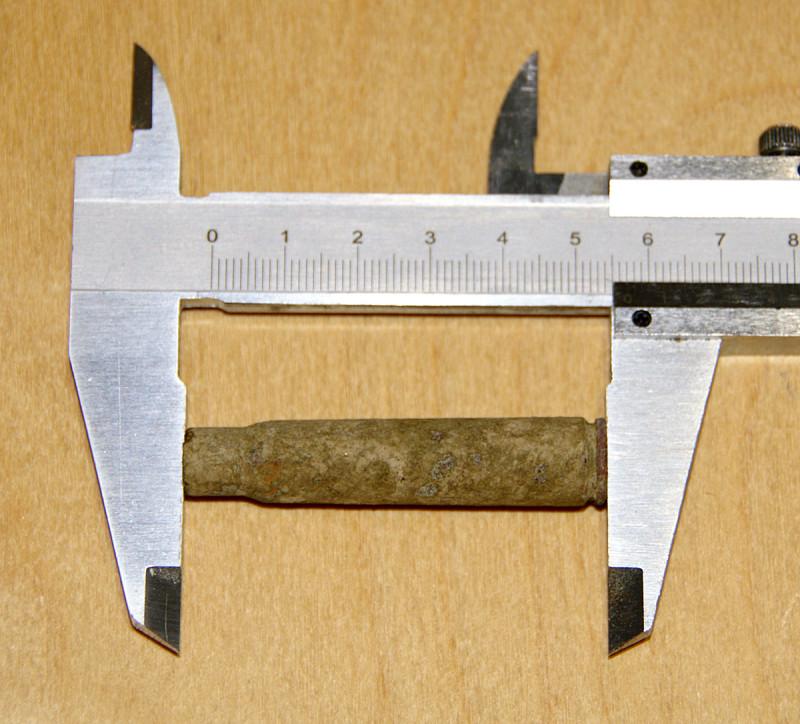 Длина гильзы примерно 58 мм.