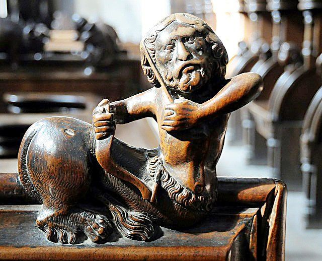 The choir stalls of the Collegiate Church of St. Ursus, Aosta, Italy. Misericords and sculptures_2