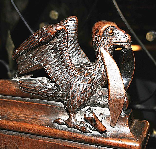 The choir stalls of the Collegiate Church of St. Ursus, Aosta, Italy. Misericords and sculptures_4