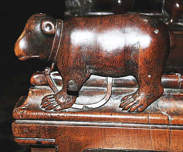 The choir stalls of the Collegiate Church of St. Ursus, Aosta, Italy. Misericords and sculptures_7