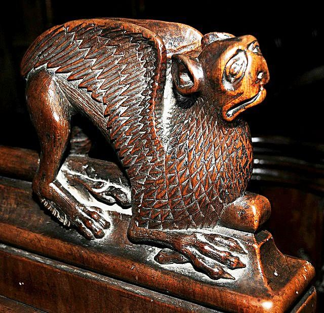 The choir stalls of the Collegiate Church of St. Ursus, Aosta, Italy. Misericords and sculptures_10
