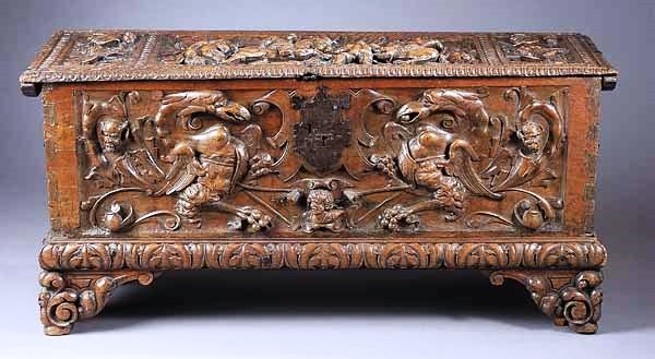 An Antique Highly Carved Continental Walnut Cassone