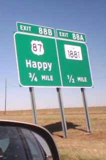 Happy is a wide spot in the road.