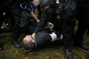 protester-choked-by-police-officer-at-Occupy-Denver-300x200