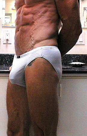 tattoo man with c-ring briefs