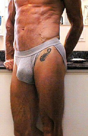 tattoo man with natural support briefs