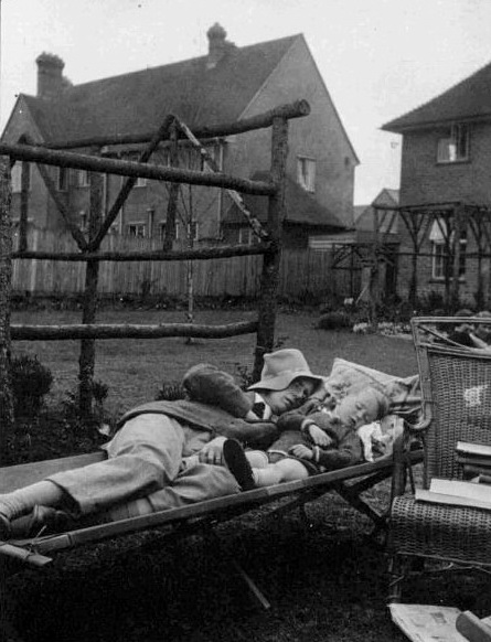 Tolkien and Christopher napping in back garden