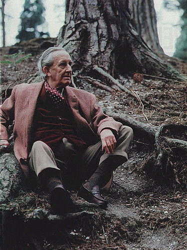 Tolkien seated in front of a tree bole, colour