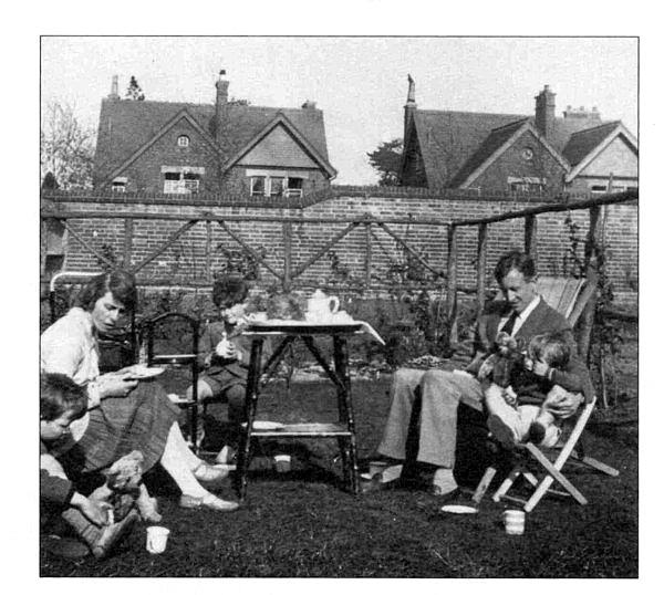 family having tea in back garden