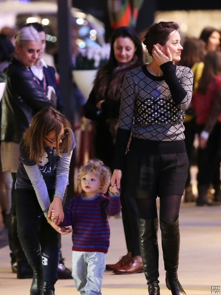 Marion-Cotillard-And-Baby-Marcel-Attend-Another-Day-Of-The-Gucci-Paris-Masters-December-2012-4-435x580