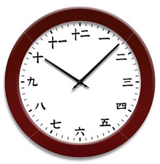 istockphoto_594689-japanese-kanji-numbers-clock