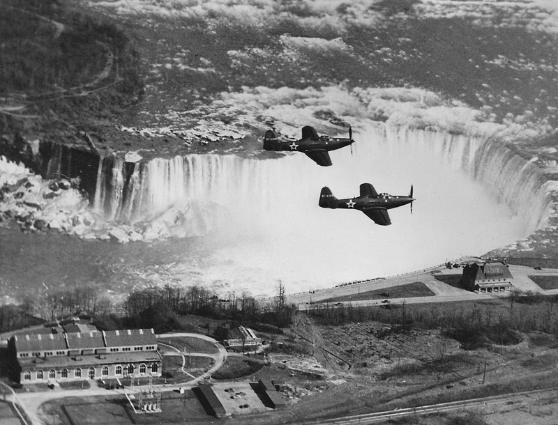 Soviet lend-lease Bell P-63 Kingcobra's in flight over Niagara Falls, ca.1943