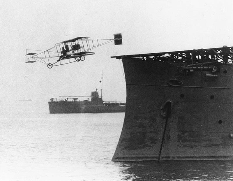 1910. Civilian Eugene Ely piloted the first aircraft to take-off from a ship, cruiser USS Birmingham