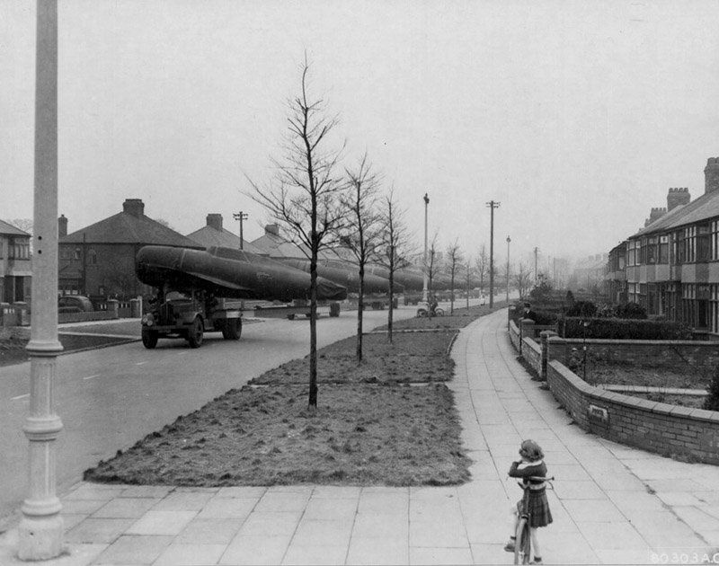 1943 P47 Thunderbolts being transported through the streets of Liverpool