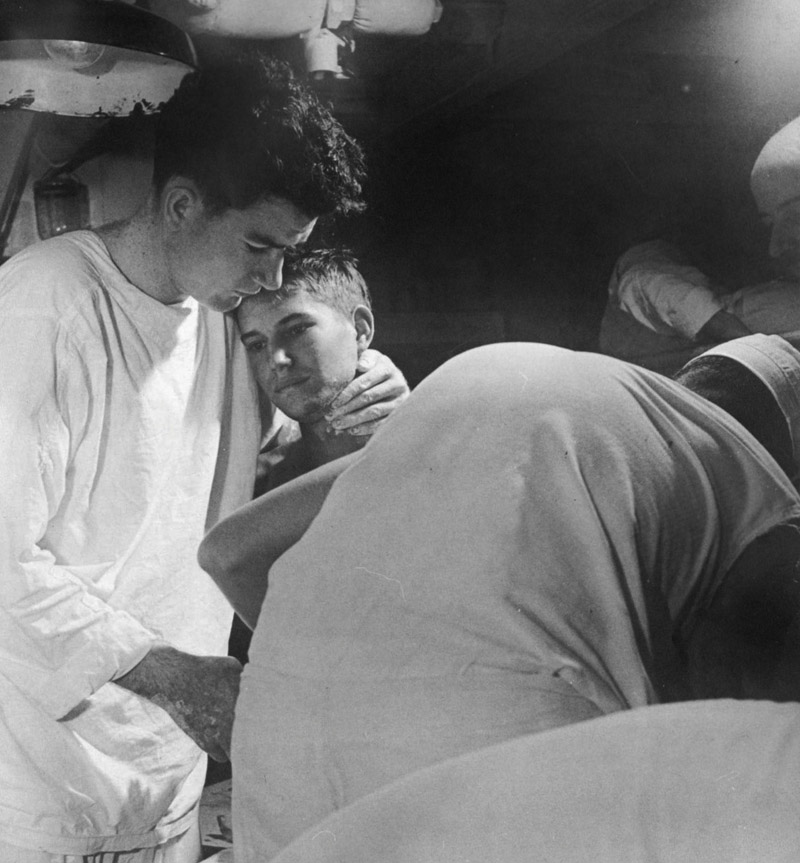 Chaplain comforting a casualty on board the hospital ship USS Solace, May 1945