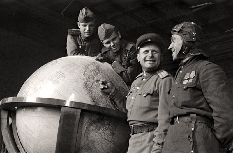 Soviet soldiers pose with 'Hitler's Globe', Germany 1945