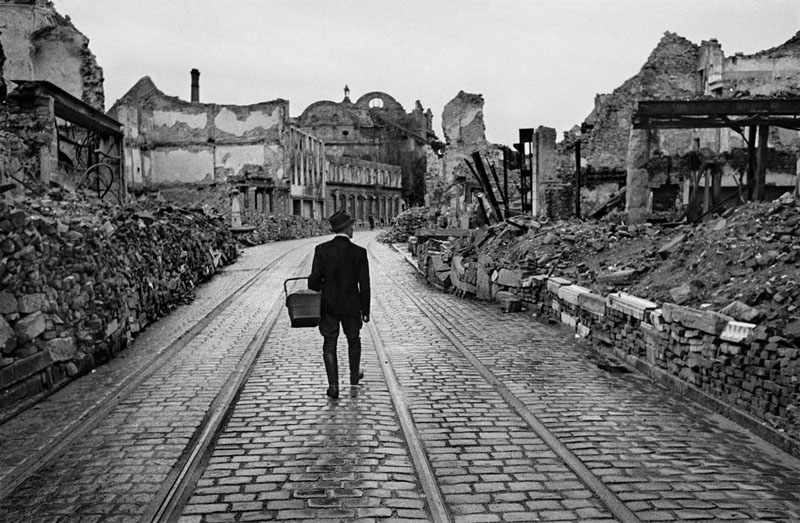 Werner Bischof 1945 A man walks through the destroyed city looking for food.