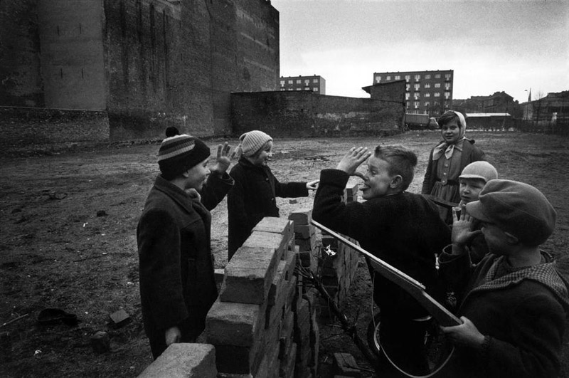 "In West Berlin children play ""building the Wall,""  February 1962"