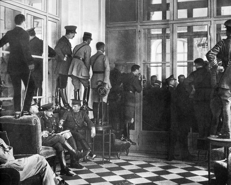 Spectators standing upon couches, tables and chairs to get even a glimpse of the Versailles Treaty being signed, France, 1919 [800x641]