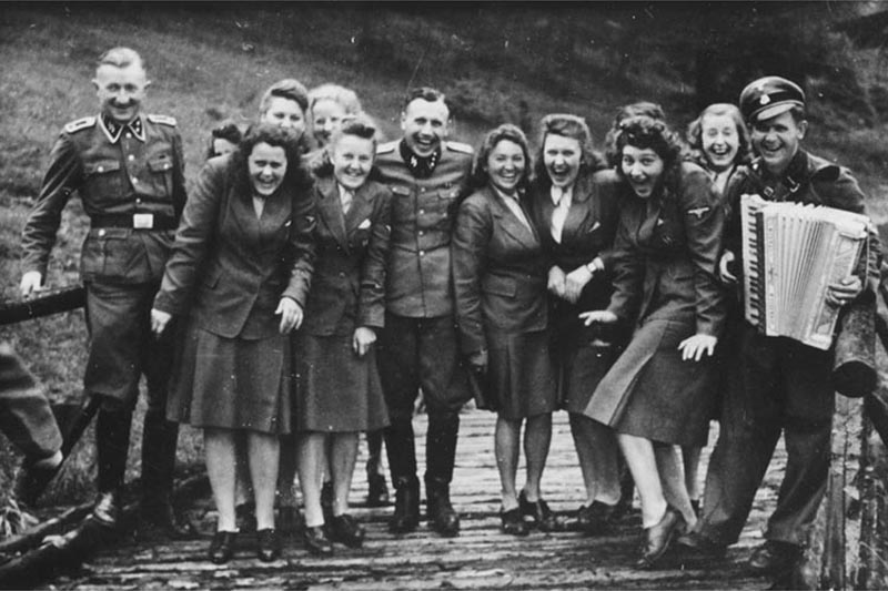 SS auxiliaries poses at a resort for Auschwitz personnel. From laughing at Auschwitz c. 1942