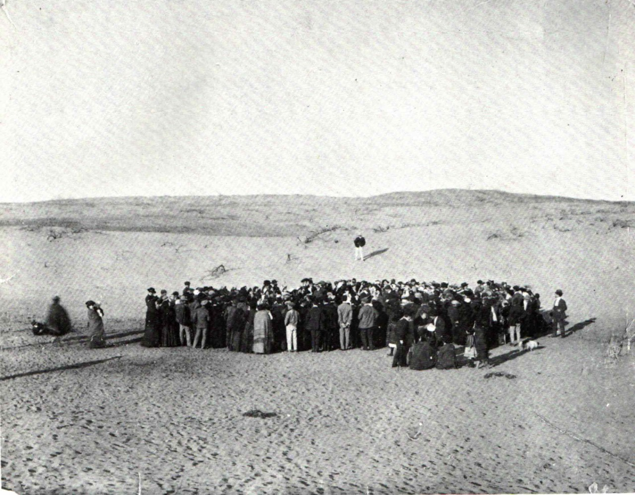 About 100 people participate in a lottery to equally divide a 12-acre plot of sand dunes they've purchased, that would later become the city of Tel Aviv, Israel.