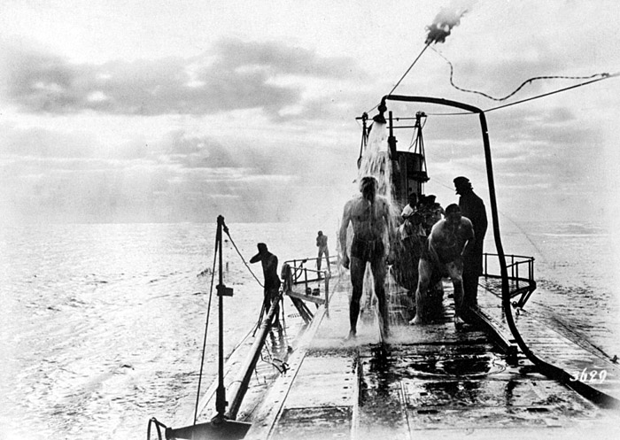 The crew of German submarine U-35 take a shower on deck, somewhere in the Mediterranean, 1917