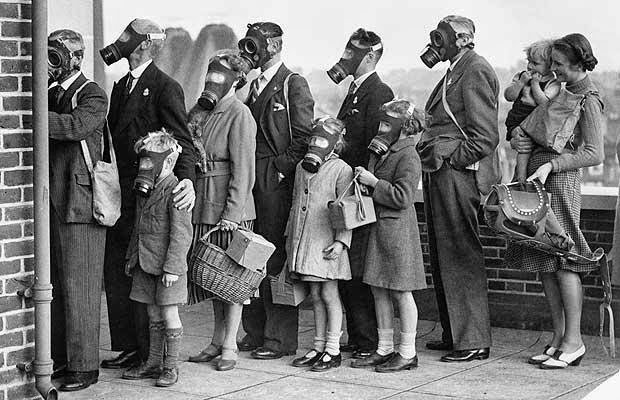 10 A group of civilians queuing to try out their gas mask in a gas testing chamber, 1939