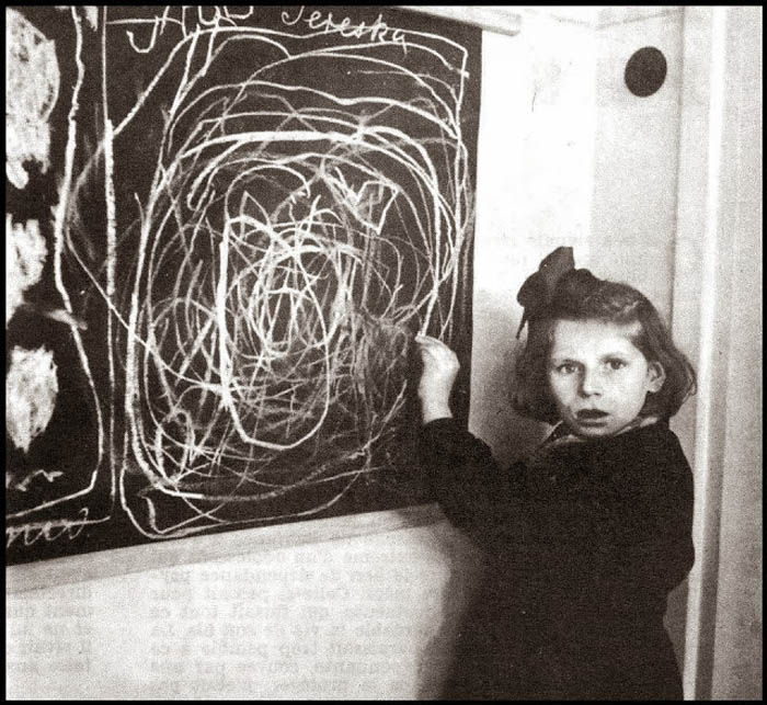 A girl who grew up in a concentration camp draws a picture of 'Home' while living in a residence for disturbed children. Poland, 1948