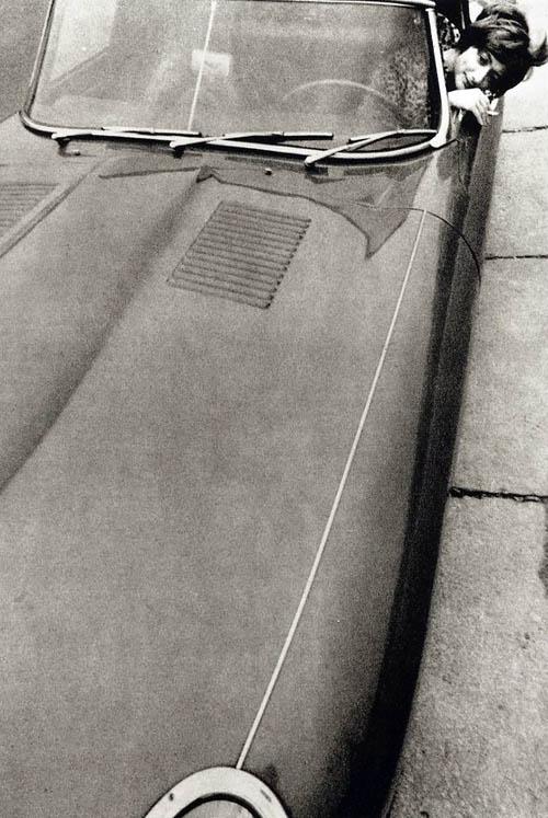 Helmut Newton. Francoise Sagan in her Jaguar XK140. 1963