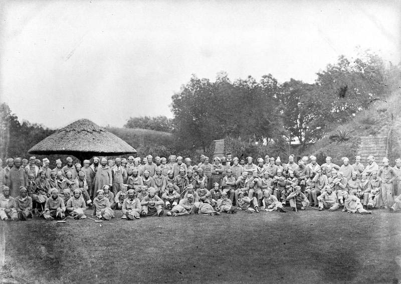 Wounded soldiers assemble in the grounds of Chatham Hospital in Kent during a visit by Queen Victoria during the Crimean War.