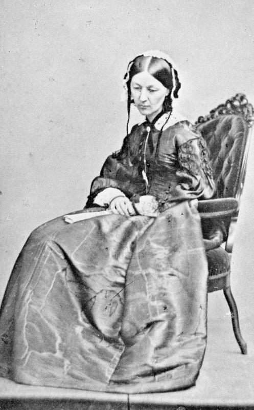 Portrait of Florence Nightingale (1820 - 1910) seated in a chair with fan, c 1860.