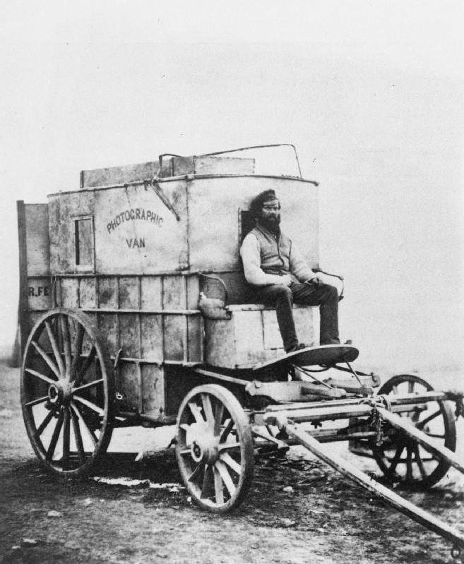 The photographer Roger Fenton's assistant, Marcus Sparling, sitting on the van which Fenton used as a travelling darkroom and living accommodation in the Crimea.