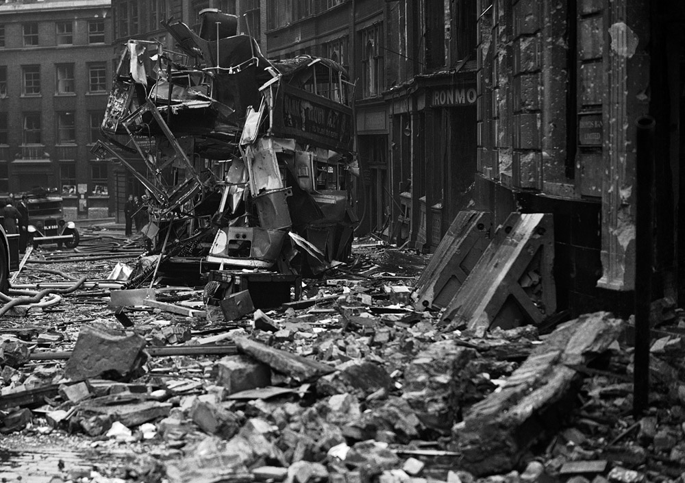 A London Bus lies in ruin after a German bombing raid during the Blitz, 1940