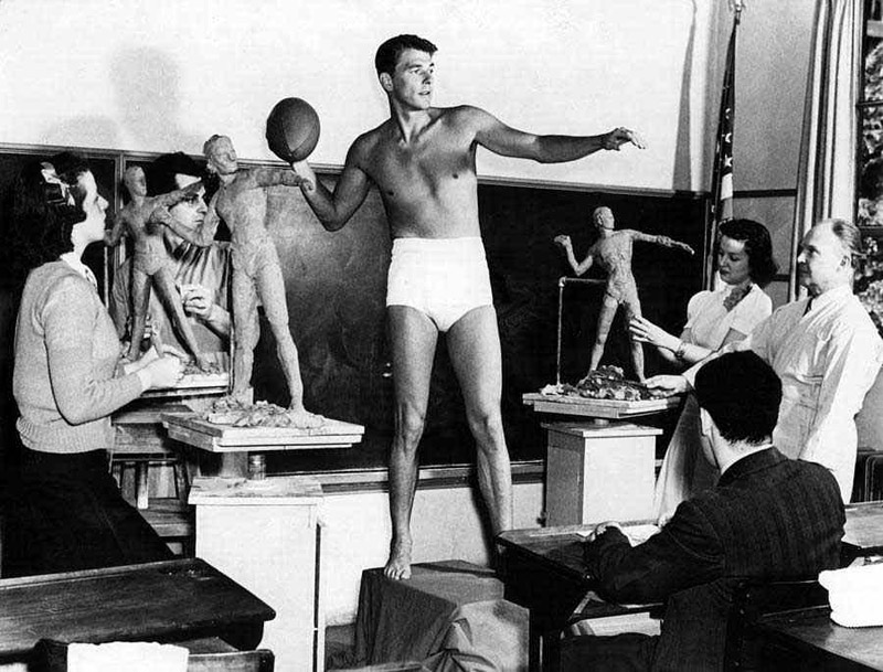 """Ronald Reagan poses for a sculpture class at USC as an example of """"ideal male physique"""", 1940"""