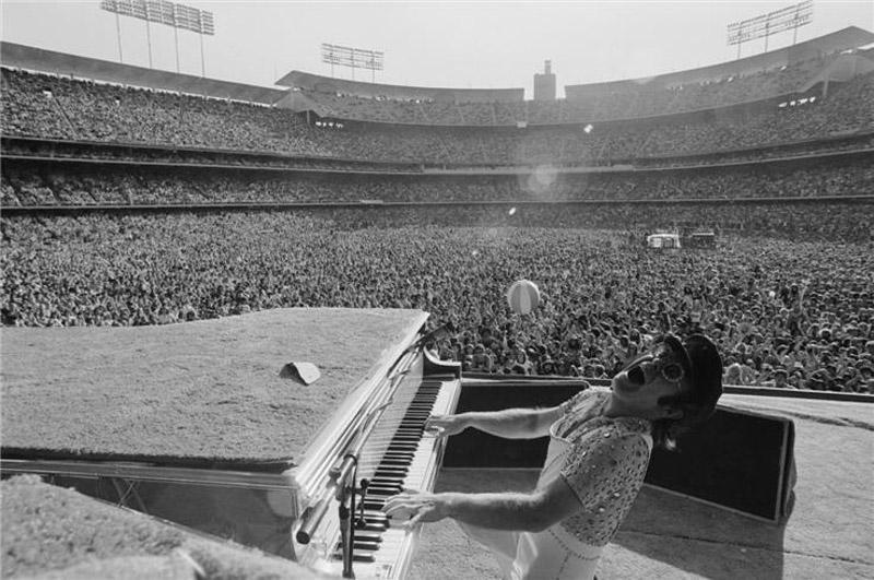 Elton John performs at the Dodger Stadium in Los Angeles, October 1975