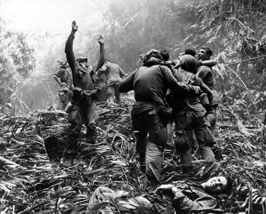 101st Airborne paratroopers signaling a helicopter to evacuate their wounded, 1968