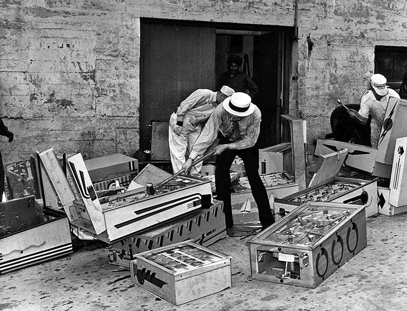 Confiscated pinball games being destroyed by city officials after ban. Los Angeles, May 1940