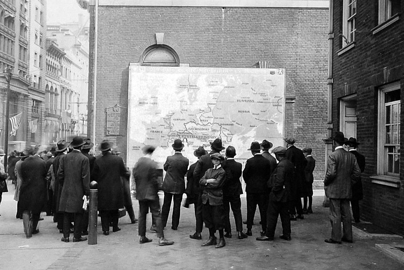 People on a street outside Independence Hall examining a new map of Europe shortly before the end of World War I, Philadelphia, October 1918.
