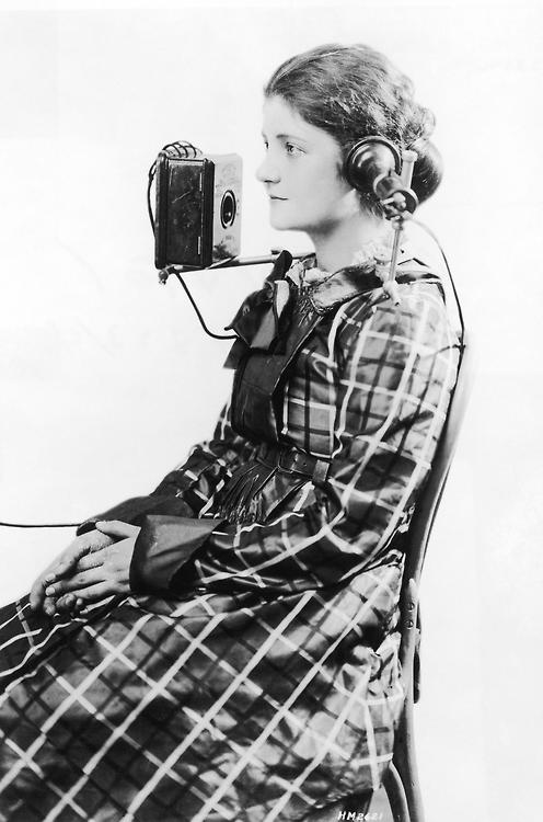 "A telephone operator wears a ""portable"" headset made by the American Bell Telephone Company, 1923"