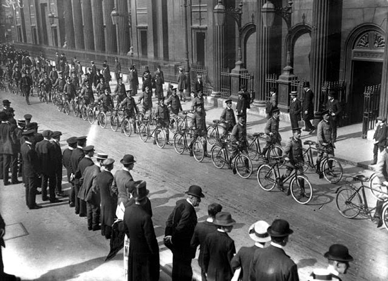 Automobile Association bicycle scouts in procession on their way to Liverpool Street Station, en route to camp, September 1914