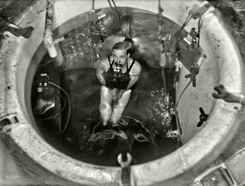 "Washington, D.C., 1931. ""Man partially submerged in tank with breathing apparatus"