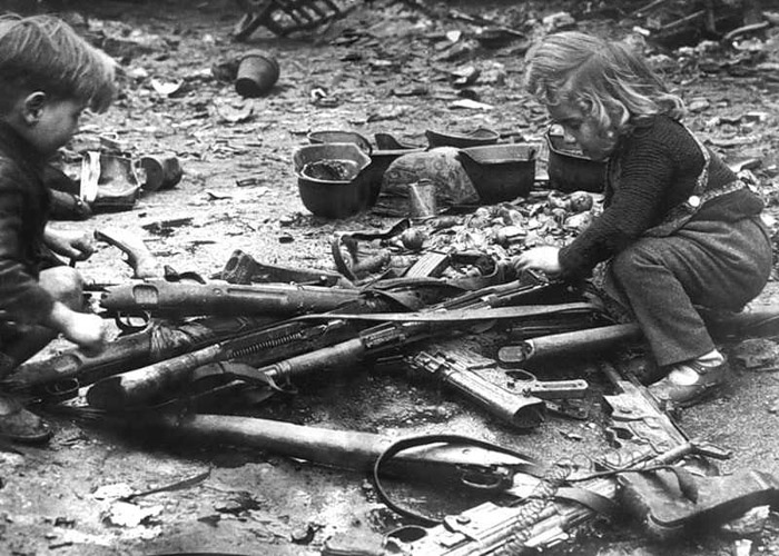 Children playing with weapons left in the streets of Berlin, 1945