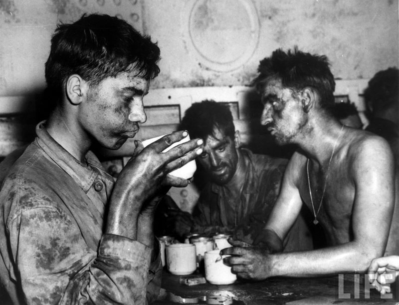 Marines drinking coffee after 2 days and 2 nights of fighting on Eniwetok Atoll, 1944, WWII.