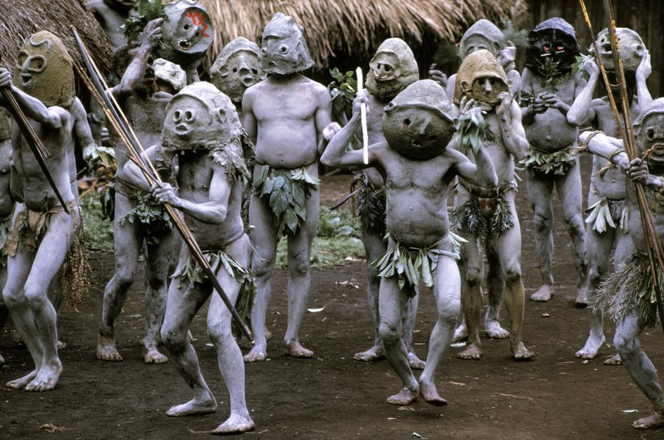 Tribe preparations for a pig killing in a village near Goroka, New Guinea