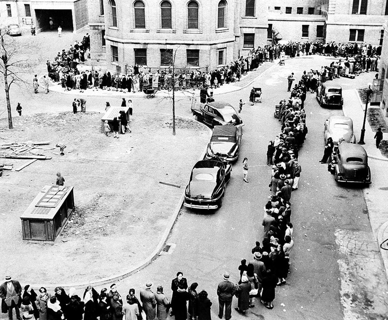 In April 1947, people stand in line waiting to be inoculated against smallpox at the Morrisania Hospital in New York